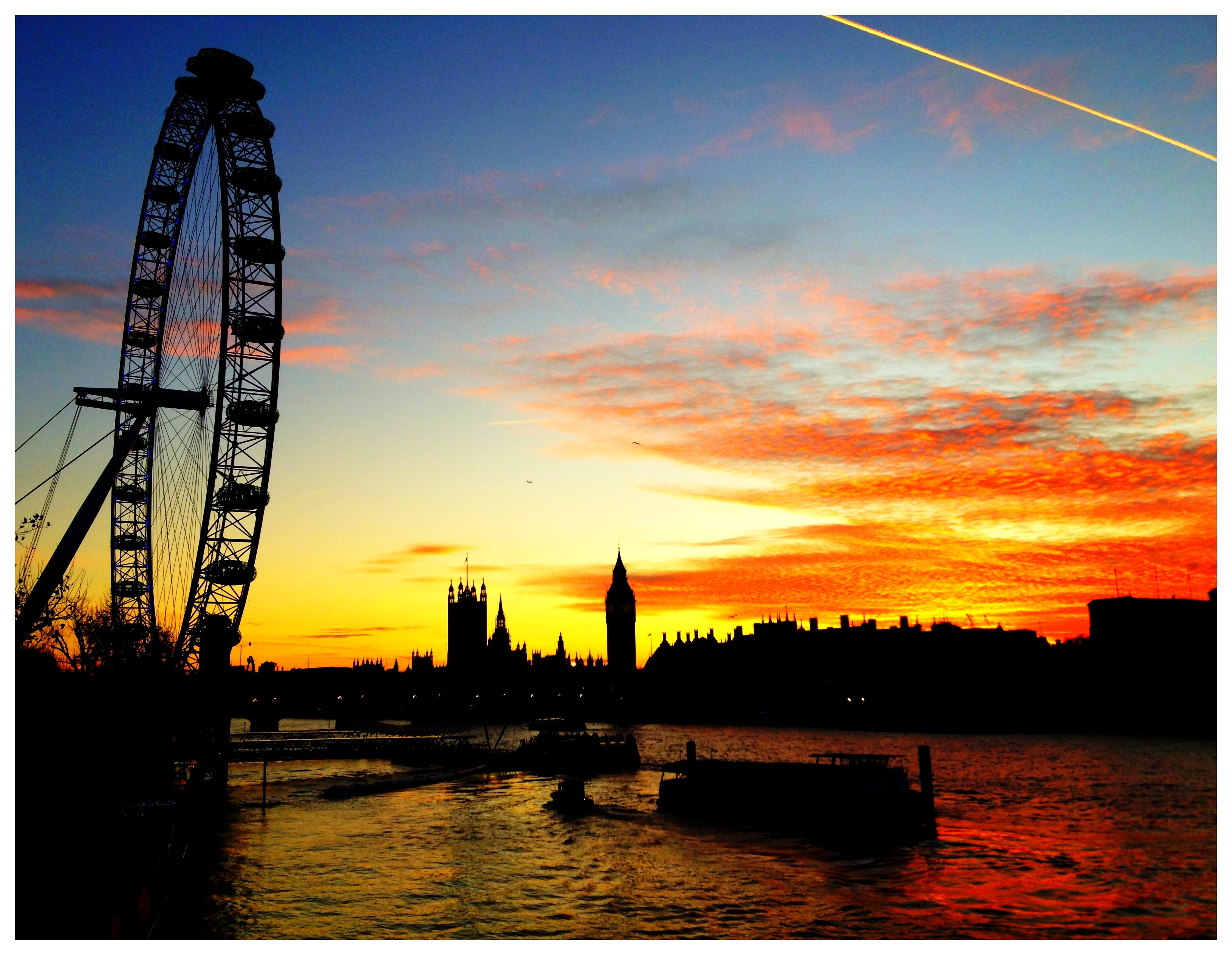 Big Ben, Houses of Parliament and The London Eye as the Sun Goes Down